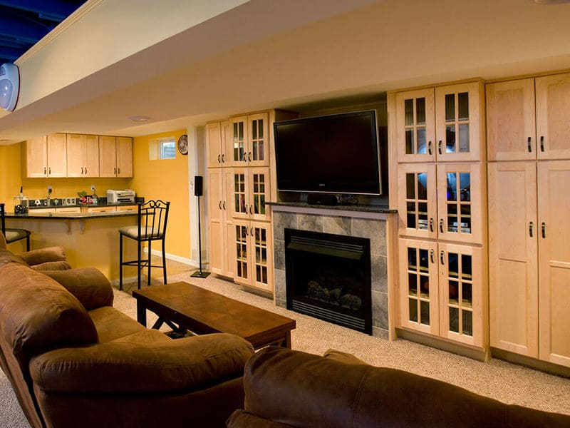 Sports-Themed Basement Remodel with Bar and Custom TV Cabinetry | Maximize Functionality in Your New Jersey Home with Custom Built Ins | JMC Home Improvement Specialists