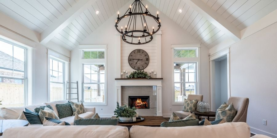 bold chandelier and ceiling treatment in transitional style living room