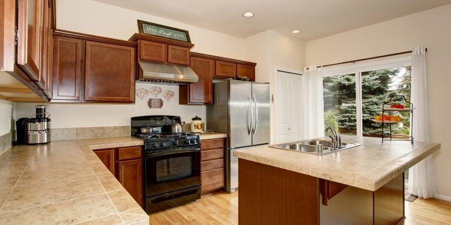 tan ceramic tile kitchen countertops in modern kitchen update