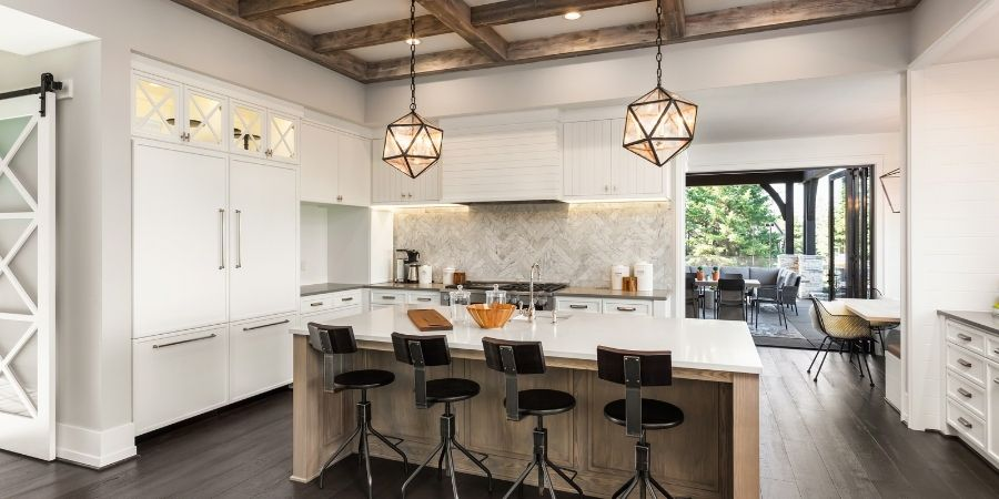 transitional style kitchen with drop pendant lighting and metal and wood accents