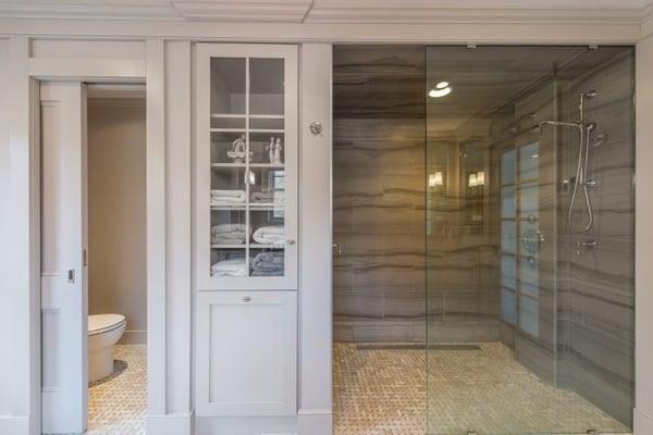 Master bedroom bathroom remodeling ideas - linen closet with built-in laundry hamper