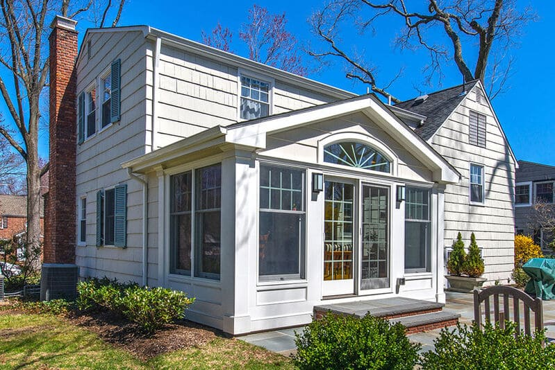 Exterior Sunroom with French doors and arch window in Chatham, NJ renovated by JMC Home Improvement Specialists