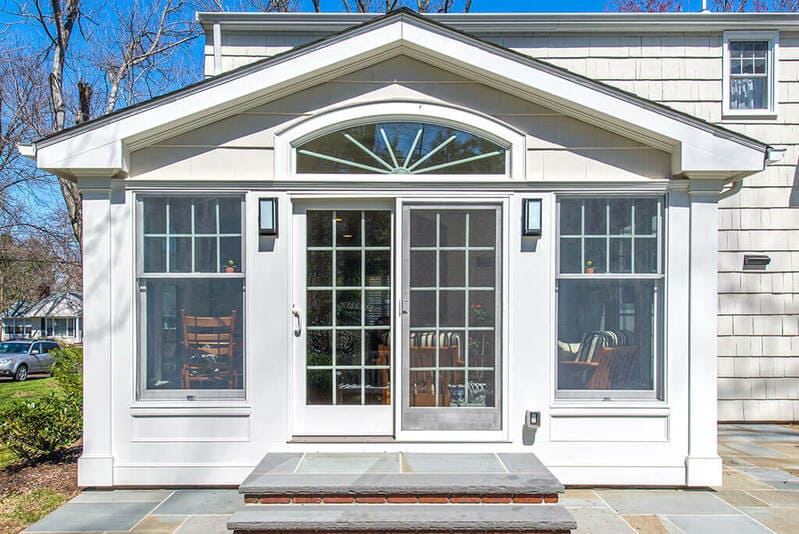 Exterior Sunroom with French doors and arch window in Morris County, New Jersey renovated by JMC Home Improvement Specialists