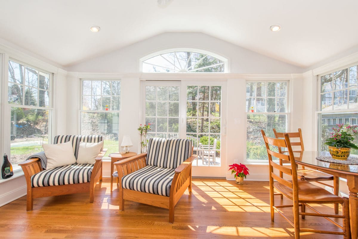 White Sunroom with vaulted ceiling and transom window in Chatham, NJ renovated by JMC Home Improvement Specialists