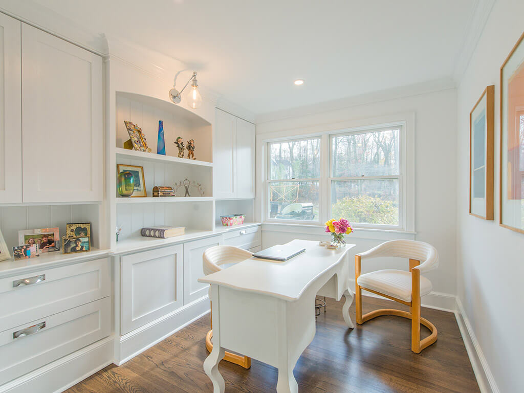 """White office with 7"""" oak floors with white cabinetry, retro lighting with custom shelving with decorative display in Boonton, NJ renovated by JMC Home Improvement Specialists"""