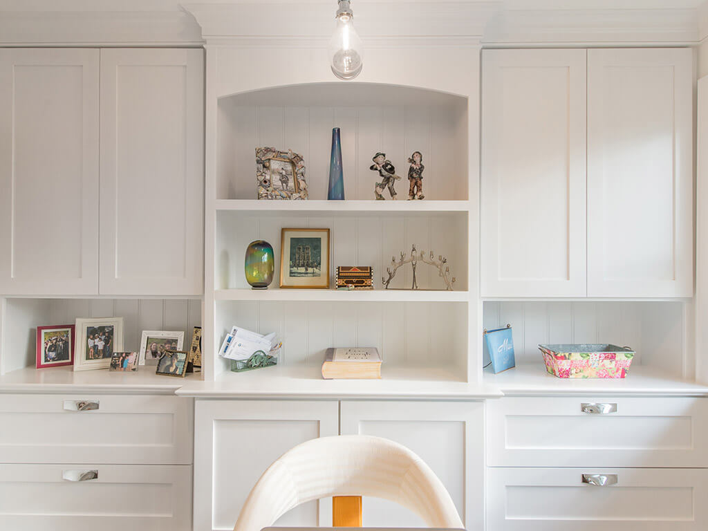 White office with white cabinetry and custom shelving with decorative display in Morris County, NJ renovated by JMC Home Improvement Specialists
