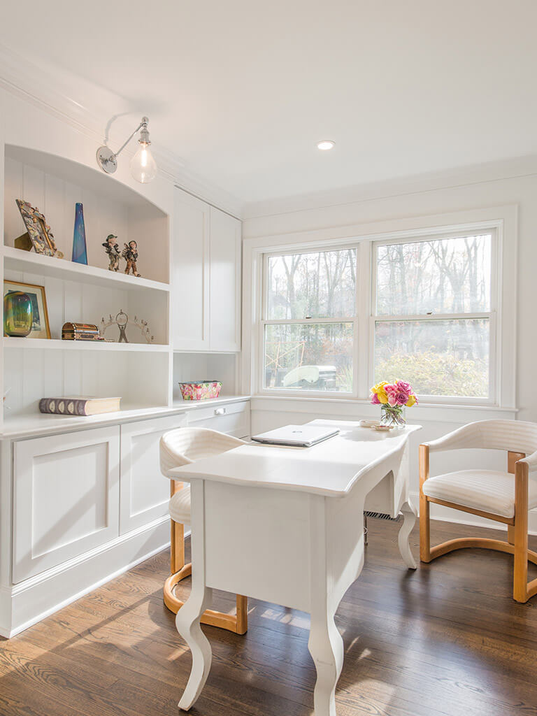 """White office with 7"""" oak floors with white cabinetry, retro lighting with custom shelving with decorative display in Morris County, NJ renovated by JMC Home Improvement Specialists"""
