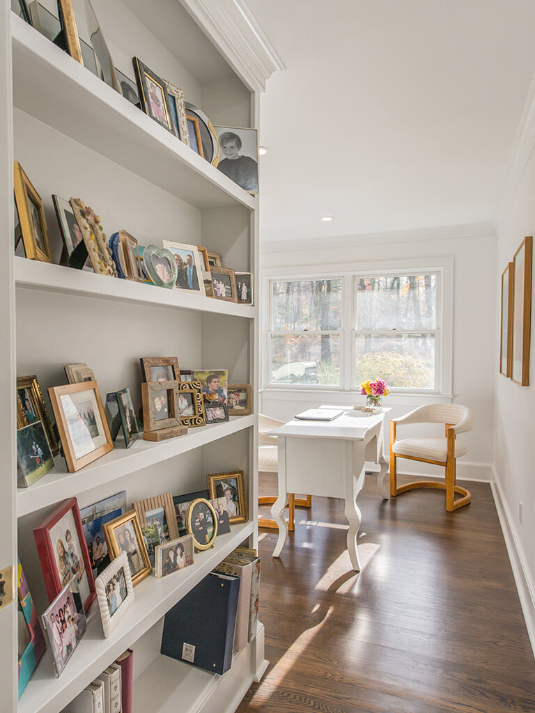 """White home office with 7"""" oak floors and bookshelf in Boonton, NJ renovated by JMC Home Improvement Specialists"""