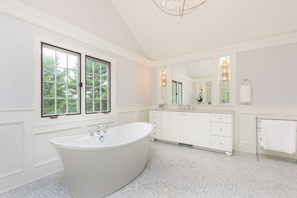 Award Winning Elegant White Master Bathroom Remodel with Custom Wood Panel and Sconces with Soaking Tub in Morris Township New Jersey Renovated by JMC Home Improvement Specialists