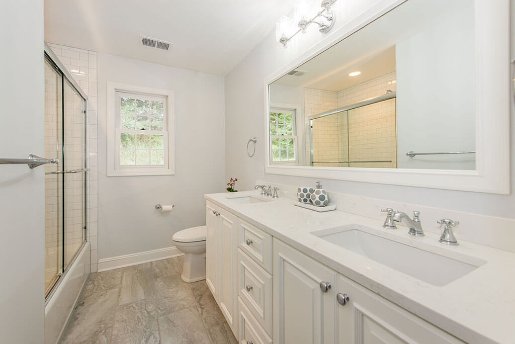 White Hall Bath Remodel in Morris Township New Jersey with Quartz Countertop Vanity Framed Mirror and Wood Floor Tile Renovated by JMC Home Improvement Specialists