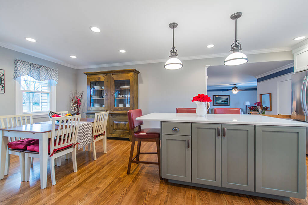 White and Grey two tone kitchen remodel with hardwood flooring, quartz counters, pendant lighting over island in Parsippany, NJ remodeled by JMC Home Improvement Specialists