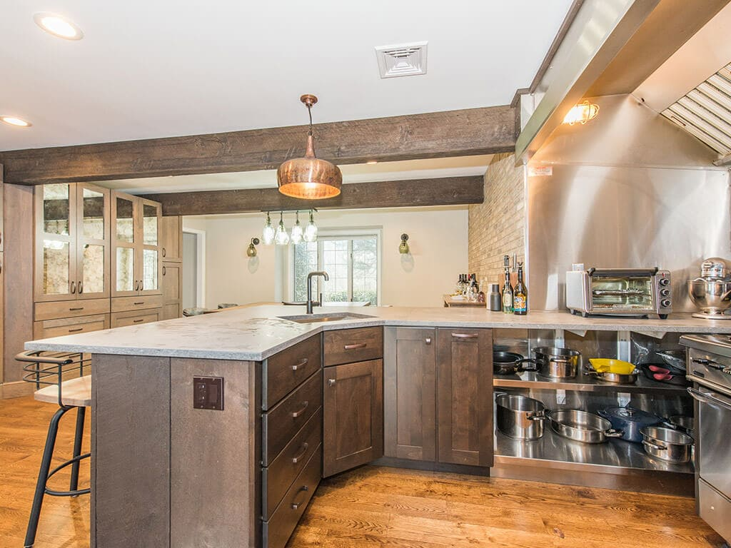 Open concept industrial kitchen with concrete countertop in Rockaway, NJ remodeled by JMC Home Improvement Specialists