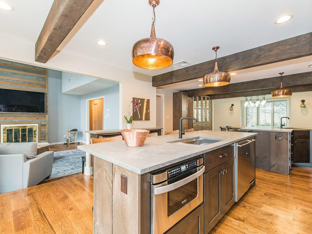 Open floor plan industrial kitchen with wood beams, concrete countertop in Rockaway, NJ remodeled by JMC Home Improvement Specialists