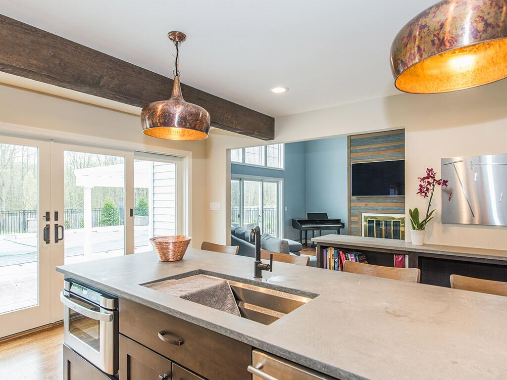 Rustic Open floor plan industrial kitchen, wood beams, concrete countertop with undermount sink in Rockaway, NJ remodeled by JMC Home Improvement Specialists