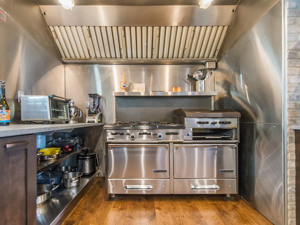 Industrial kitchen, with professional range and hood and open metal shelving in Rockaway, NJ remodeled by JMC Home Improvement Specialists