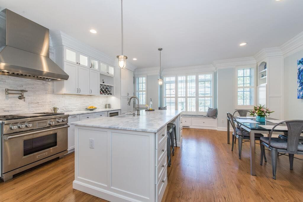 White kitchen with metal freestanding hood and pot filler in Morristown, NJ remodeled by JMC Home Improvement Specialists